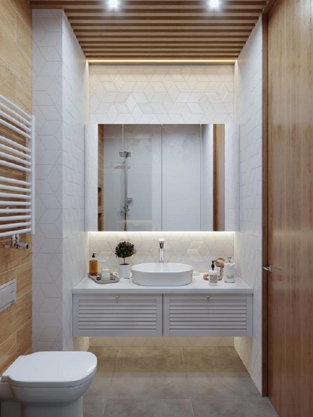 Nhà vệ sinh với tone màu trắng - nâu gỗ tạo không gian sáng, thoáng mát, không bí bức