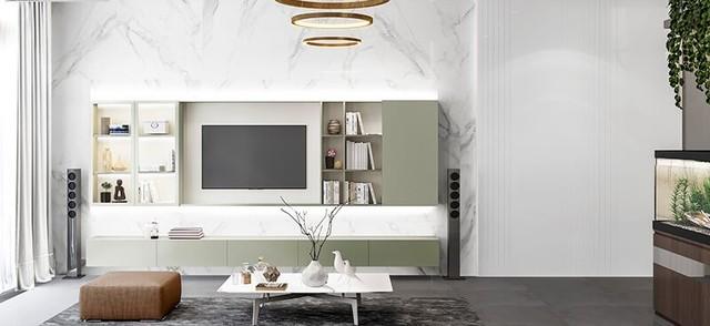 Sử dụng vật liệu gỗ ốp tường cao cấp, đèn trang trí trần nhà kiểu vòng acrylic, tất cả tạo nên sự sang trọng ấm cúng