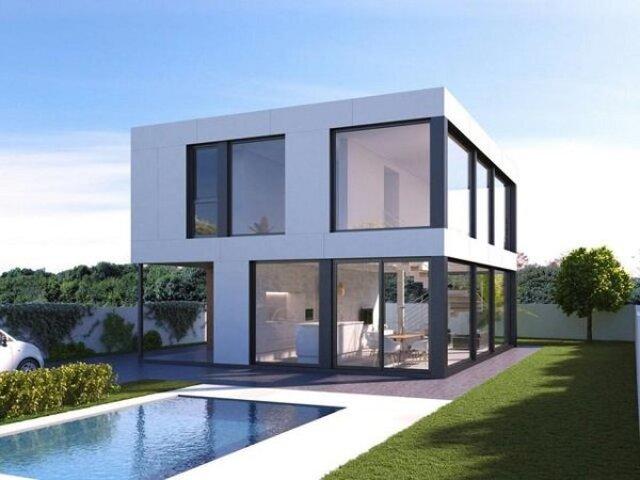 Thiết kế nhà vuông cửa kính như thế này giúp bạn tận dụng được tối đa ánh sáng và sự thông thoáng cho nhà bạn.