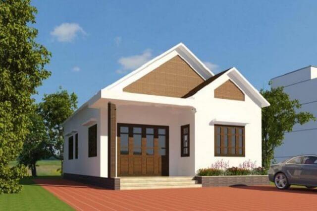 Mẫu thiết kế nhà cấp 4 với mái thái mang hơi hướng hiện đại cùng sự kết hợp của gam màu trắng nhẹ nhàng đan xen với những khung cửa gỗ mộc mạc tạo nên sự hài hoà cho căn nhà.