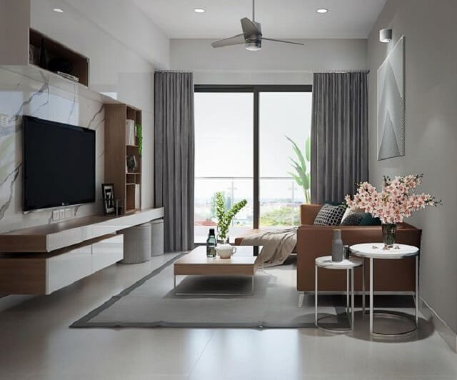 Phòng khách nhỏ gọn nhưng ấm cúng. Cửa kính lớn giúp không gian sáng và thoáng mát hơn.