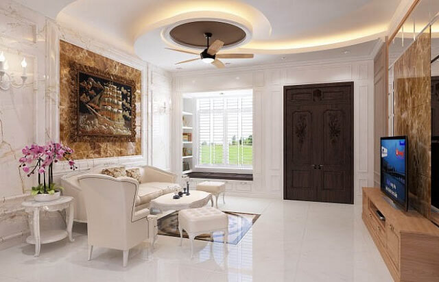 Bộ bàn ghế màu trắng kết hợp với bức tranh lớn với cuộc phiêu lưu trên biển, cửa làm gỗ có hoa văn mang phong cách cổ điển.